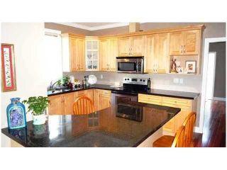 Photo 4: 1988 SANDOWN PL in North Vancouver: Pemberton NV House for sale : MLS®# V1057031