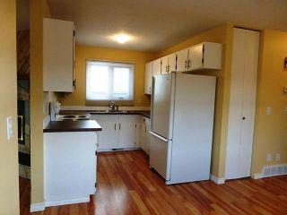 Photo 2: 43 DOVERGLEN Crescent SE in CALGARY: Dover Glen Residential Detached Single Family for sale (Calgary)  : MLS®# C3617661