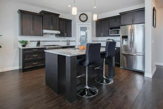 Photo 4: 106 Reunion Green NW: Airdrie Detached for sale : MLS®# A1065745
