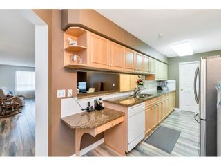 "Photo 12: 331 13880 70 Avenue in Surrey: East Newton Condo for sale in ""Chelsea Gardens"" : MLS®# R2528464"