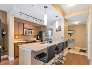 """Photo 4: 220 2110 ROWLAND Street in Port Coquitlam: Central Pt Coquitlam Townhouse for sale in """"AVIVA ON THE PARK"""" : MLS®# R2598714"""
