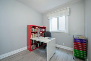 Photo 20: 48 Tremblant Terrace SW in Calgary: Springbank Hill Detached for sale : MLS®# A1131887
