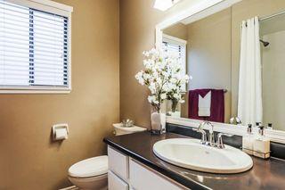 "Photo 16: 7387 142 Street in Surrey: East Newton House for sale in ""Nichol Creek Estates"" : MLS®# R2228884"
