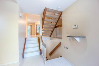 Photo 7: 7050 Edgemont Drive NW in Calgary: Edgemont Row/Townhouse for sale : MLS®# A1108400
