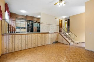 Photo 33: 128 Dovertree Place SE in Calgary: Dover Semi Detached for sale : MLS®# A1075565