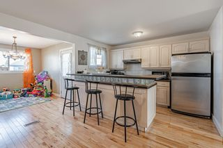 Photo 7: 288 Pensville Close SE in Calgary: Penbrooke Meadows Row/Townhouse for sale : MLS®# A1091204