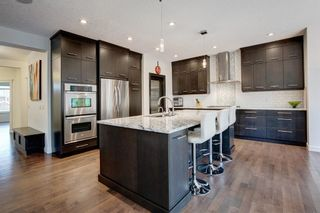 Photo 2: 127 Springbluff Boulevard SW in Calgary: Springbank Hill Detached for sale : MLS®# A1140601