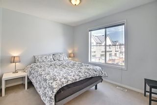 Photo 25: 28 Everhollow Way SW in Calgary: Evergreen Row/Townhouse for sale : MLS®# A1122910