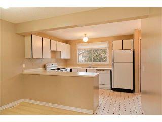 Photo 2: 151 WOODMONT Terrace SW in Calgary: Woodbine House for sale : MLS®# C4061057