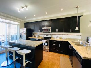 """Photo 9: 79 6383 140 Street in Surrey: Sullivan Station Townhouse for sale in """"PANORAMA WEST VILLAGE"""" : MLS®# R2543747"""