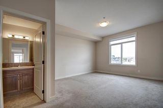 Photo 22: 304 132 1 Avenue NW: Airdrie Apartment for sale : MLS®# A1091993