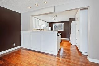 Photo 2: 818 68 Avenue SW in Calgary: Kingsland Detached for sale : MLS®# A1068540
