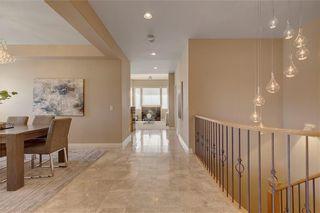 Photo 3: 5 STRADDOCK Villa SW in Calgary: Strathcona Park Semi Detached for sale : MLS®# C4293573
