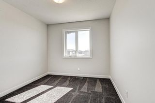 Photo 29: 136 Creekside Drive SW in Calgary: C-168 Semi Detached for sale : MLS®# A1108851