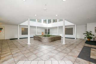 """Photo 2: 201 19241 FORD Road in Pitt Meadows: Central Meadows Condo for sale in """"Village Greem"""" : MLS®# R2617880"""