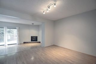 Photo 3: 5 3302 50 Street NW in Calgary: Varsity Row/Townhouse for sale : MLS®# A1147127