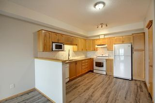 Photo 8: 320 223 Tuscany Springs Boulevard NW in Calgary: Tuscany Apartment for sale : MLS®# A1132465