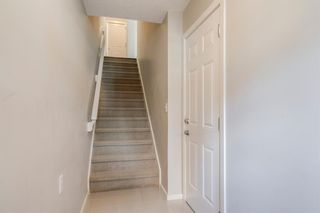 Photo 8: 235 ASCOT Circle SW in Calgary: Aspen Woods Row/Townhouse for sale : MLS®# A1025064