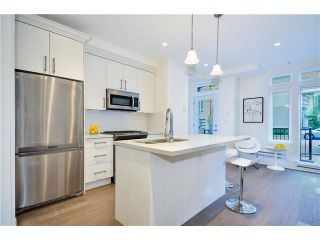 """Photo 2: 3711 COMMERCIAL Street in Vancouver: Victoria VE Townhouse for sale in """"O2"""" (Vancouver East)  : MLS®# V1025256"""