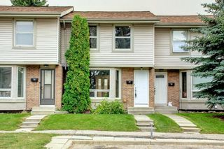 Photo 2: 77 123 Queensland Drive SE in Calgary: Queensland Row/Townhouse for sale : MLS®# A1145434