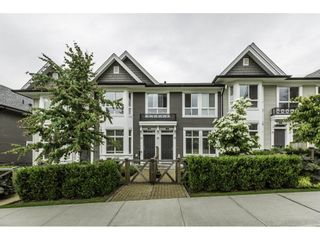 """Photo 1: 11 14433 60 Avenue in Surrey: Sullivan Station Townhouse for sale in """"BRIXTON"""" : MLS®# R2179960"""