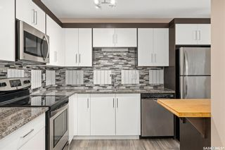 Photo 1: 9 215 Pinehouse Drive in Saskatoon: Lawson Heights Residential for sale : MLS®# SK864976