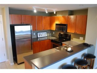 """Photo 3: 313 7089 MONT ROYAL Square in Vancouver: Champlain Heights Condo for sale in """"CHAMPLAIN VILLAGE"""" (Vancouver East)  : MLS®# V838473"""