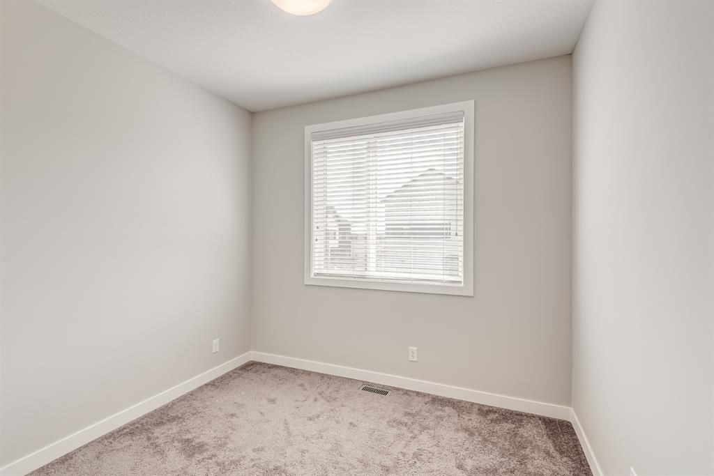 Photo 15: Photos: 125 Redstone Crescent NE in Calgary: Redstone Row/Townhouse for sale : MLS®# A1124721
