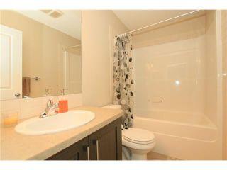 Photo 15: 7 FIRESIDE Parkway: Cochrane House for sale : MLS®# C4068645