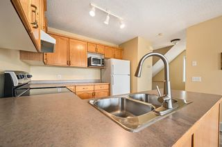 Photo 5: 154 Bridleglen Road SW in Calgary: Bridlewood Detached for sale : MLS®# A1113025
