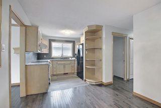 Photo 10: 4527 26 Avenue SE in Calgary: Dover Semi Detached for sale : MLS®# A1105139