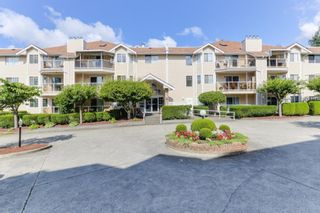 """Photo 1: 126 22611 116 Avenue in Maple Ridge: East Central Condo for sale in """"Rosewood Court Fraserview Village"""" : MLS®# R2388587"""