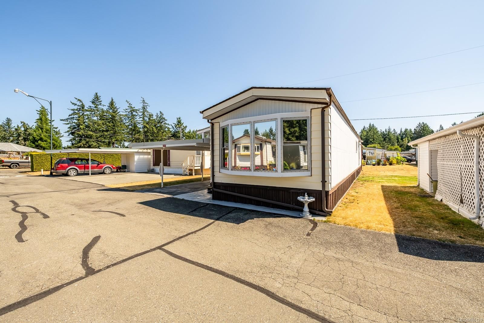 Main Photo: 49 1240 Wilkinson Rd in : CV Comox Peninsula Manufactured Home for sale (Comox Valley)  : MLS®# 886123