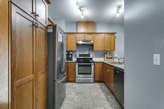 Photo 6: 204 720 Willowbrook Road NW: Airdrie Row/Townhouse for sale : MLS®# A1123024