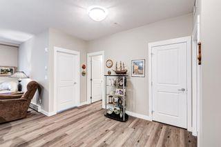 Photo 12: 310 200 Auburn Meadows Common SE in Calgary: Auburn Bay Apartment for sale : MLS®# A1153208