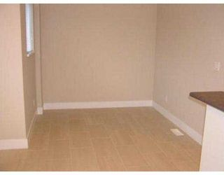 """Photo 7: 14 7833 HEATHER ST in Richmond: McLennan North Townhouse for sale in """"BELMONT"""" : MLS®# V536702"""
