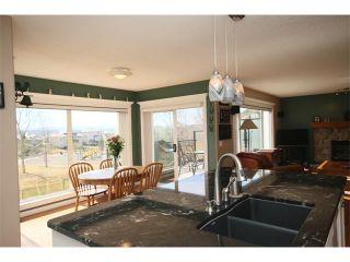 Photo 20: 51 GLENEAGLES View: Cochrane House for sale : MLS®# C4008842