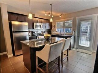 Photo 7: 2 1302 Russell Road NE in Calgary: Renfrew Row/Townhouse for sale : MLS®# A1146794