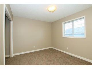 Photo 33: 74 WEST TERRACE Road: Cochrane House for sale : MLS®# C4073559