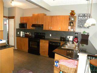 Photo 4: 186 EVERGLEN CR SW in CALGARY: Evergreen House for sale (Calgary)  : MLS®# C3607020