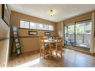 """Photo 7: 3345 MOUNTAIN Highway in North Vancouver: Lynn Valley Townhouse for sale in """"VILLAGE ON THE CREEK"""" : MLS®# V1141033"""