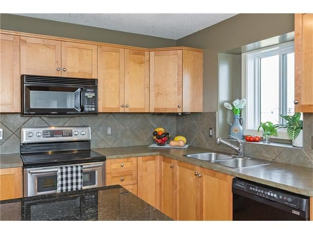 Photo 14: Photos: 664 LUXSTONE Landing SW: Airdrie House for sale : MLS®# C4106944