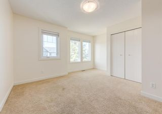 Photo 22: 402 2445 Kingsland Road SE: Airdrie Row/Townhouse for sale : MLS®# A1107683