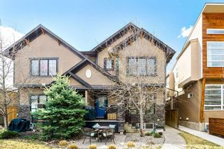 Photo 1: 1 4711 17 Avenue NW in Calgary: Montgomery Row/Townhouse for sale : MLS®# A1135461
