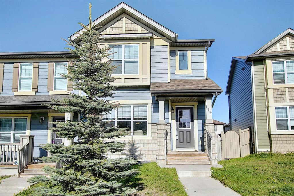 Main Photo: 144 PANAMOUNT Way NW in Calgary: Panorama Hills Semi Detached for sale : MLS®# A1114610