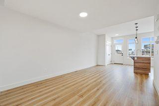 Photo 5: 101 Heartland Street: Cochrane Semi Detached for sale : MLS®# A1095665