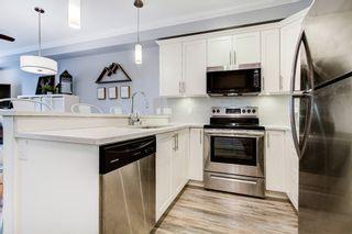 """Photo 3: 405 8183 121A Street in Surrey: Queen Mary Park Surrey Condo for sale in """"Celeste"""" : MLS®# R2544049"""