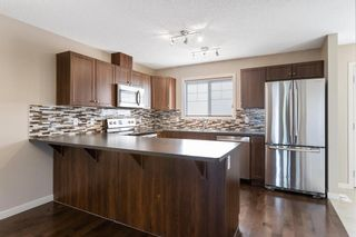 Photo 4: 122 Sunset Road: Cochrane Row/Townhouse for sale : MLS®# A1127717
