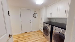 Photo 12: 94 Sunset Way SE in Calgary: Sundance Detached for sale : MLS®# A1136113