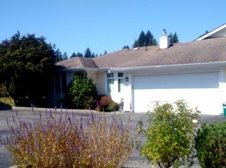 """Photo 1: 63 20762 TELEGRAPH Trail in Langley: Walnut Grove Townhouse for sale in """"Woodbridge"""" : MLS®# R2394375"""